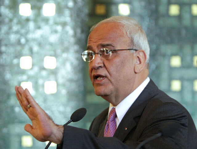 FILE - In this Oct. 2, 2011 file photo, chief Palestinian negotiator Saeb Erekat, speaks during a press conference at the Arab League headquarters in Cairo, Egypt. Erekat, a veteran peace negotiator and prominent international spokesman for the Palestinians for more than three decades, has died Tuesday, Nov. 10, 2020. He was 65. (AP Photo/Amr Nabil, File)
