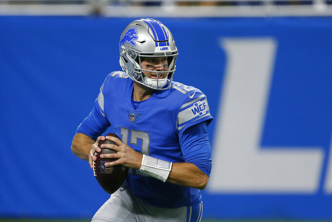 Detroit Lions quarterback Tim Boyle looks downfield during the first half of a preseason NFL football game against the Indianapolis Colts, Friday, Aug. 27, 2021, in Detroit. (AP Photo/Duane Burleson)