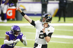 Jacksonville Jaguars quarterback Mike Glennon throws a pass in front of Minnesota Vikings cornerback Jeff Gladney (2) during the first half of an NFL football game, Sunday, Dec. 6, 2020, in Minneapolis. (AP Photo/Bruce Kluckhohn)