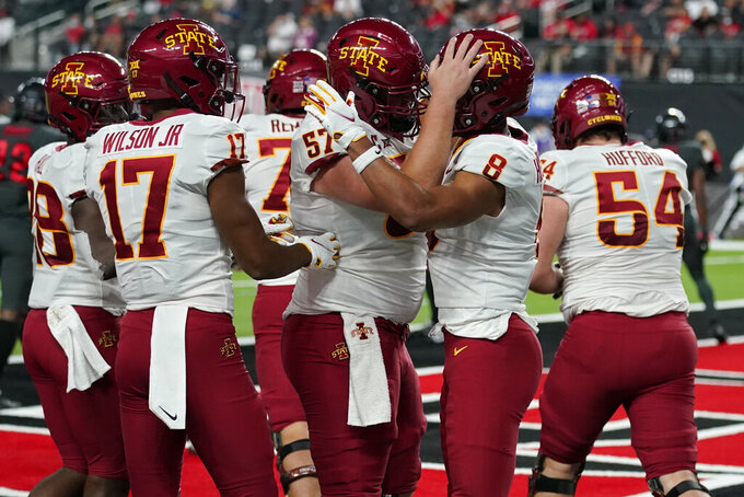 Iowa State offensive lineman Colin Newell (57) celebrates after wide receiver Xavier Hutchinson (8) scored a touchdown against UNLV during the second half of an NCAA college football game Saturday, Sept. 18, 2021, in Las Vegas. (AP Photo/John Locher)
