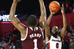 Georgia guard William Jackson II (0) shots a 3-pointer while being defended by Mississippi State forward Reggie Perry (1) during an NCAA college basketball game in Athens, Ga., Wednesday, Feb. 20, 2019. (Joshua L. Jones/Athens Banner-Herald via AP)