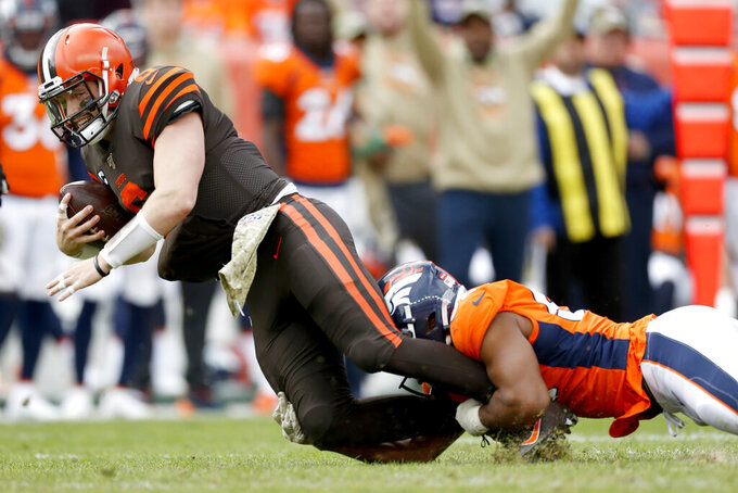 Cleveland Browns quarterback Baker Mayfield (6) is sacked by Denver Broncos linebacker Justin Hollins during the first half of NFL football game, Sunday, Nov. 3, 2019, in Denver. (AP Photo/David Zalubowski)