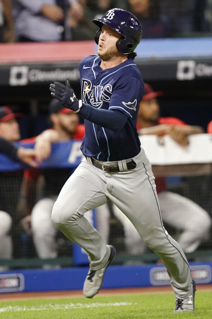 Tampa Bay Rays' Brett Phillips heads home to score during the ninth inning of the team's baseball game against the Cleveland Indians, Thursday, July 22, 2021, in Cleveland. Tampa won 5-4 in 10 innings. (AP Photo/Tony Dejak)