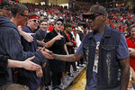 Former NBA star Dennis Rodman talks to Texas Tech fans during the first half of an NCAA college basketball game against Texas, Saturday, Feb. 29, 2020, in Lubbock, Texas. (AP Photo/Brad Tollefson)