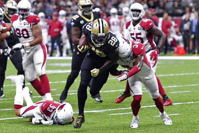 New Orleans Saints running back Latavius Murray (28) carries for a touchdown against Arizona Cardinals defensive back Jalen Thompson (34) in the first half of an NFL football game in New Orleans, Sunday, Oct. 27, 2019. (AP Photo/Bill Feig)