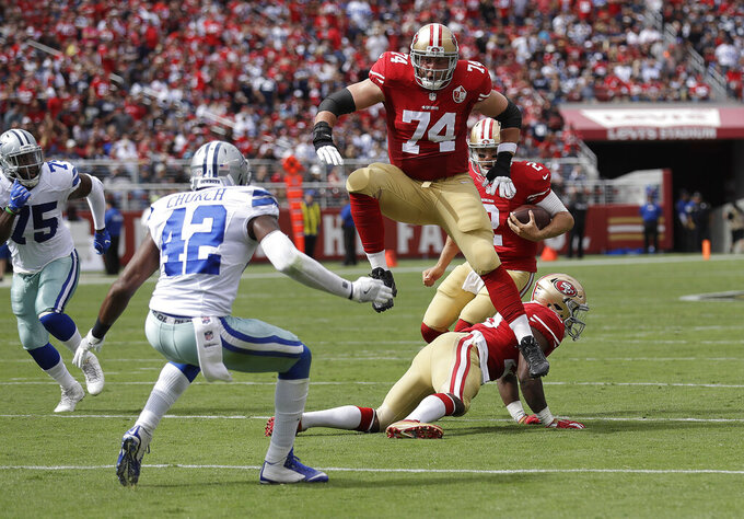 FILE - In this Oct. 2, 2016, file photo, San Francisco 49ers offensive tackle Joe Staley (74) blocks for quarterback Blaine Gabbert (2) against the Dallas Cowboys during the first half of an NFL football game in Santa Clara, Calif. Staley was the one constant in San Francisco during a more than decade-long roller coaster that saw the 49ers go from the basement to the Super Bowl twice in a career that ended with his retirement last week. (AP Photo/Marcio Jose Sanchez, File)