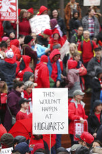 In this April 10, 2019, photo, educators from across the metro hold a rally during a Take it to the MAX event in Portland, Ore., to press the Oregon Legislature for more school funding. Tens of thousands of teachers are expected to walk out across Oregon this week, adding to the string of nationwide protests over class sizes and education funding. (Mark Graves/The Oregonian via AP)