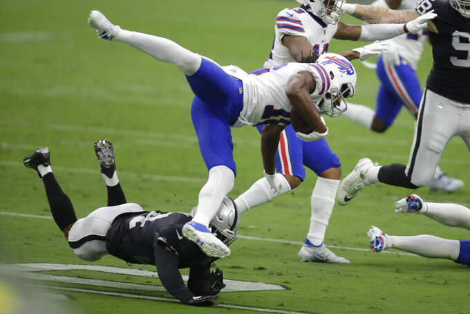 Las Vegas Raiders strong safety Johnathan Abram (24) tackles Buffalo Bills wide receiver Andre Roberts (18) during the first half of an NFL football game, Sunday, Oct. 4, 2020, in Las Vegas. (AP Photo/Isaac Brekken)