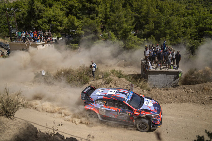 Pierre Louis Loubet and his co driver Vincent Florian Haut Labourdette go France with their Hyundai i20 coupe WRC car compete in the WRC Acropolis Rally at the stage of Aghii Theodori, west of Athens, on Friday, Sept. 10, 2021. The World Rally Championship returned to Greece after an eight-year absence. (AP Photo/Petros Giannakouris)