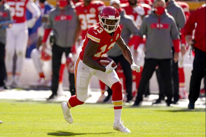 Kansas City Chiefs wide receiver Byron Pringle (13) catches a pass for a first down in the first half of an NFL football game against the New York Jets on Sunday, Nov. 1, 2020, in Kansas City, Mo. (AP Photo/Charlie Riedel)