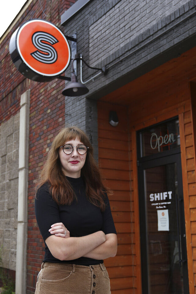 This July 21, 2020 photo shows SHIFT Cyclery & Coffee Bar employee Liz Carey who has been out of work since the shop closed in March and now faces the potential loss of federal Pandemic Unemployment Compensation. (Dan Reiland/The Eau Claire Leader-Telegram via AP)
