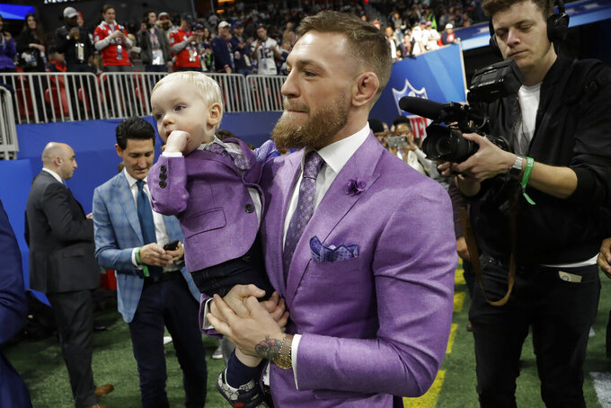 THIS CORRECTS FROM  CONNER TO CONOR: UFC Champion Conor McGregor enters the field, before the NFL Super Bowl 53 football game between the Los Angeles Rams and the New England Patriots Sunday, Feb. 3, 2019, in Atlanta. (AP Photo/Lynne Sladky)