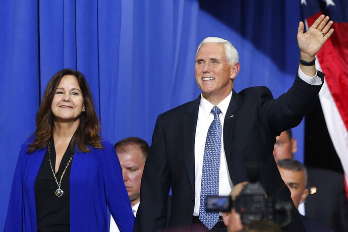 FILE - In this Oct. 10, 2019 file photo, Vice President Mike Pence and his wife Karen arrive prior to a campaign rally speech by appear in Minneapolis. Vice President Pence is bringing President Donald Trump's law-and-order campaign message to Minneapolis on Thursday, Sept. 24, 2020, showing support for law enforcement in the city where George Floyd's death after police tried to arrest him sparked angry and sometimes violent protests that spread around the world. (AP Photo/Jim Mone, File)