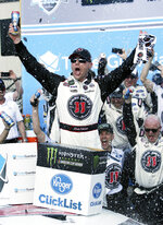 Monster Energy NASCAR Cup Series driver Kevin Harvick (4) celebrates after winning a NASCAR Cup Series auto race on Sunday, March 11, 2018, in Avondale, Ariz. (AP Photo/Rick Scuteri)