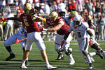 Boston College quarterback Dennis Grosel (6) is rushed by Louisville defensive back Russ Yeast (3) during the second half of an NCAA college football game in Louisville, Ky., Saturday, Oct. 5, 2019. Louisville won 41-39. (AP Photo/Timothy D. Easley)