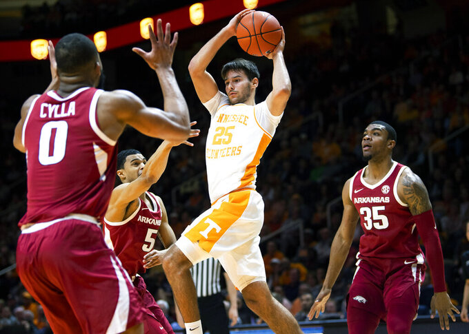Tennessee guard Santiago Vescovi (25) passes the ball to a teammate during an NCAA college basketball game against Arkansas, Tuesday, Feb. 11, 2020 in Knoxville, Tenn. (Brianna Paciorka/Knoxville News Sentinel via AP)