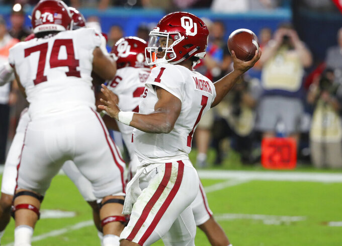 FILE - In this Dec. 29, 2018, file photo, Oklahoma quarterback Kyler Murray (1) looks to pass during the first half of the Orange Bowl NCAA college football game against Alabama, in Miami Gardens, Fla. Representatives of the Oakland Athletics and Major League Baseball met Sunday, Jan. 13, 2019, with Heisman Trophy winner Murray, a day before the quarterback's deadline to enter the NFL draft, a person with direct knowledge of the session said. (AP Photo/Wilfredo Lee, File)