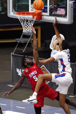 Boise State guard Derrick Alston Jr. shoots over SMU guard Emmanuel Bandoumel (5) during the second half of an NCAA college basketball game in the first round of the NIT, Thursday, March 18, 2021, in Frisco, Texas. (AP Photo/Tony Gutierrez)