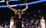 Phoenix Suns guard Kelly Oubre Jr. (3) celebrates after defeating the Boston Celtics in a basketball game in Boston, Wednesday, Dec. 19, 2018. The Suns won 111-103. (AP Photo/Charles Krupa)