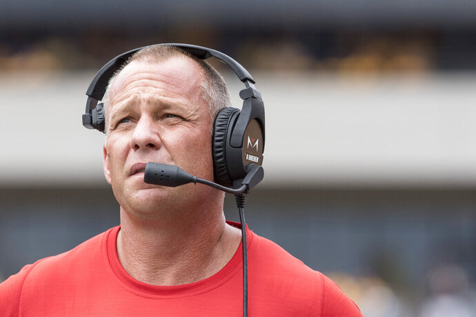 North Carolina State head coach Dave Doeren looks up at the scoreboard during the first half of an NCAA college football game against West Virginia Saturday, Sept. 14, 2019, in Morgantown, W.Va. (AP Photo/Raymond Thompson)