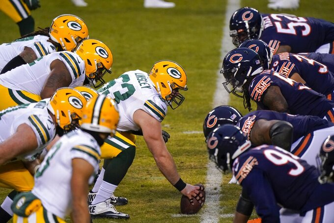 Green Bay Packers' Corey Linsley snaps the ball during the first half of an NFL football game against the Chicago Bears Sunday, Jan. 3, 2021, in Chicago. (AP Photo/Nam Y. Huh)