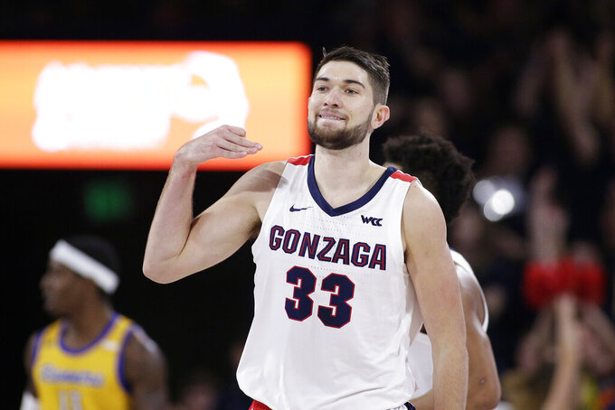 Gonzaga forward Killian Tillie (33) gestures after scoring a three-point basket during the first half of an NCAA college basketball game against Cal State Bakersfield in Spokane, Wash., Saturday, Nov. 23, 2019. (AP Photo/Young Kwak)