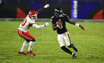 Baltimore Ravens quarterback Lamar Jackson (8) scrambles away from Kansas City Chiefs linebacker Willie Gay Jr. (50) during the second half of an NFL football game, Monday, Sept. 28, 2020, in Baltimore. (AP Photo/Gail Burton)