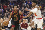 Cleveland Cavaliers' Darius Garland (10) drives against Atlanta Hawks' Cam Reddish (22) in the first half of an NBA basketball game, Wednesday, Feb. 12, 2020, in Cleveland. (AP Photo/Tony Dejak)