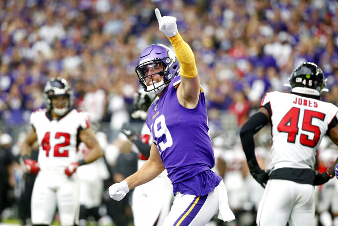 "FILE - Minnesota Vikings wide receiver Adam Thielen celebrates after catching a 23-yard touchdown pass during the first half of an NFL football game against the Atlanta Falcons, Sunday, Sept. 8, 2019, in Minneapolis. The coronavirus pandemic scuttled most college pro days, wiped out all rookie minicamps and obliterated the NFL's traditional offseason. ""Honestly, I probably wouldn't be in the NFL if this would've happened my rookie year,"" said Vikings two-time Pro Bowl receiver Adam Thielen, who went undrafted in 2013 out of Minnesota State but parlayed an impressive weekend at a rookie minicamp into a practice squad job and eventually a roster spot.(AP Photo/Bruce Kluckhohn, File)"