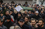 People carry the coffin of Fatma Kahraman, 63, a victim who lost her life under the rubble of an eight-story building which collapsed two days earlier in Istanbul, Friday, Feb. 8, 2019. The cause of the collapse is under investigation but a top Turkish official has said the building's top three floors were added illegally. (AP Photo/Emrah Gurel)