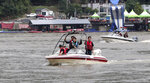 Rescue workers use boats to search for missing people in floodwaters in Gapyoeng, South Korea, Thursday, aug. 6, 2020. Torrential rains continuously pounded South Korea on Thursday, prompting authorities to close parts of highways and issue a rare flood alert near a key river bridge in Seoul. (Yang Ji-ung/Yonhap via AP)