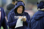 FILE - In this Jan. 4, 2020, file photo, New England Patriots head coach Bill Belichick takes notes on the sideline in the first half of an NFL wild-card playoff football game against the Tennessee Titans in Foxborough, Mass. The NFL Draft is April 23-25, 2020. (AP Photo/Charles Krupa, File)