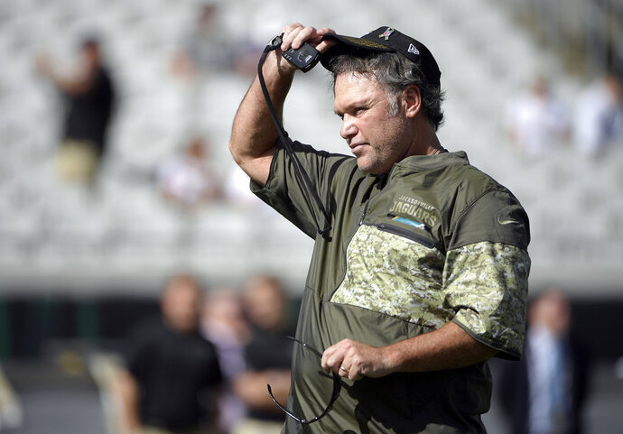 FILE - In this Nov. 12, 2017, file photo, Jacksonville Jaguars special teams coordinator Joe DeCamillis watches warmups before an NFL football game against the Los Angeles Chargers in Jacksonville, Fla.  The veteran special teams coordinator, now at Jacksonville, reflected on his time in Dallas. It was one eight coaching stops, and most painful,  during a 30-year NFL career. DeCamillis was inside Dallas' 86-foot-tall practice facility that collapsed during a thunderstorm in May 2009 injuring 12.  (AP Photo/Phelan M. Ebenhack, File)