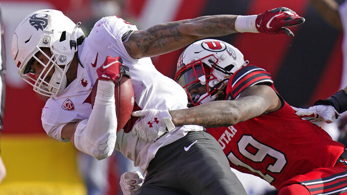 Washington State running back Deon McIntosh (3) scores against Utah safety Vonte Davis (19) during the first half of an NCAA college football game Saturday, Dec. 19, 2020, in Salt Lake City. (AP Photo/Rick Bowmer)