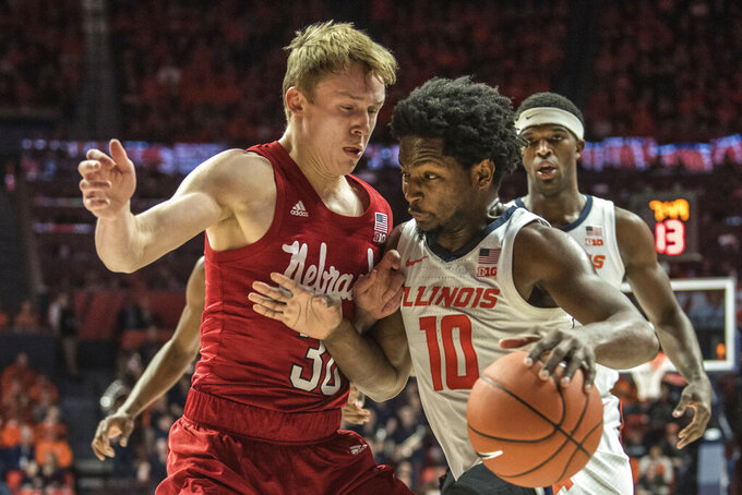 Illinois' Andres Feliz (10) powers past Nebraska's Charlie Easley (30) in the first half of an NCAA college basketball game Monday, Feb. 24, 2020, in Champaign, Ill. (AP Photo/Holly Hart)