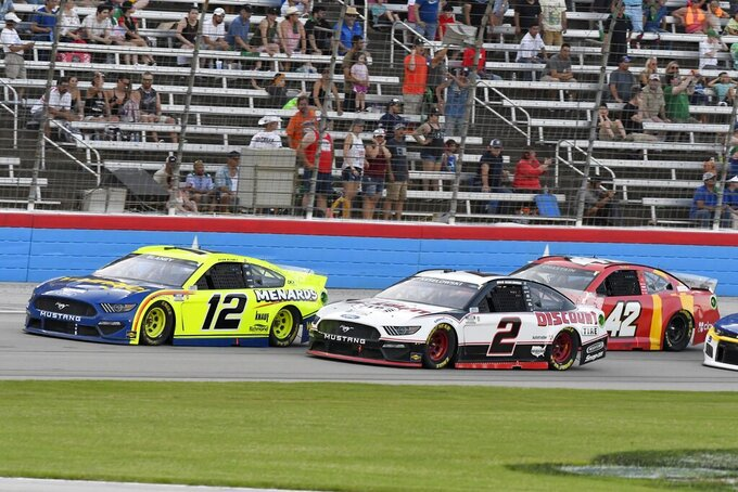 Ryan Blaney (12), Brad Keselowski (2) and Ross Chastain (42) head down the front stretch during the NASCAR Cup Series All-Star auto race at Texas Motor Speedway in Fort Worth, Texas, Sunday, June 13, 2021. (AP Photo/Larry Papke)