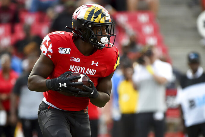 FILE - In this Sept. 7, 2019, file photo, Maryland running back Tayon Fleet-Davis runs the ball against Syracuse during the second half of an NCAA college football game in College Park, Md. Fleet-Davis and Jake Funk will likely receive the brunt of the carries, at least at the season's outset. Fleet-Davis, a senior, has 589 yards in offense and 10 touchdowns. Funk has 31 games of experience despite missing the final nine games in 2019 with a knee injury. Moreover, as Locksley enters his second season as the helm, he deals with quarterback Josh Jackson opting out of the 2020 season because of the COVID-19 pandemic and Tyrrell Pigrome has transferred to Western Kentucky. Alabama transfer Taulia Tagovailoa and redshirt freshman Lance Legendre have been competing for the starting spot this fall. (AP Photo/Will Newton, File)