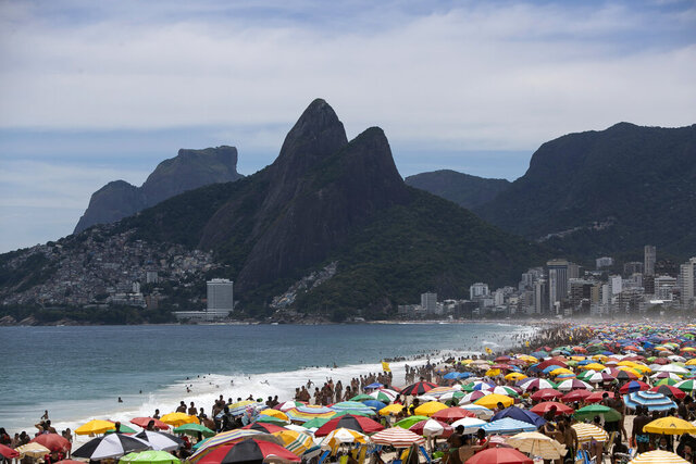 Despite restrictions to limit the spread of COVID-19, thousands crowd Ipanema Beach in Rio de Janeiro, Brazil, Sunday, Jan. 24, 2021. (AP Photo/Bruna Prado)