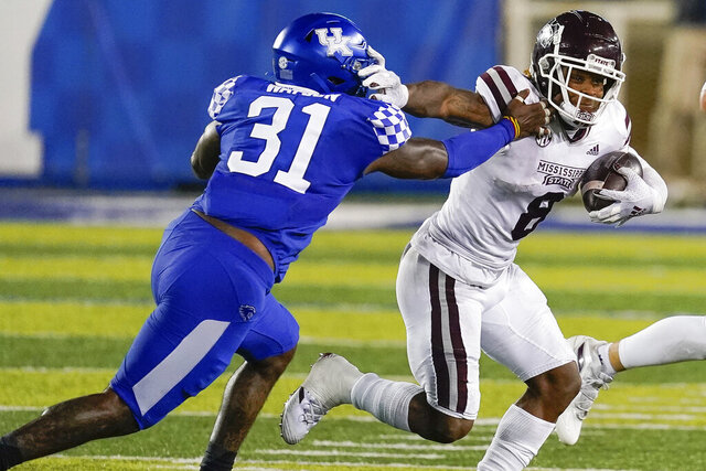 Mississippi State running back Kylin Hill (8) runs past Kentucky wide receiver Darren Edmond (31) during the second half of an NCAA college football game, Saturday, Oct. 10, 2020, in Lexington, Ky. (AP Photo/Bryan Woolston)