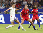 England's Lucy Bronze, left, and United States' Lindsey Horan challenge for the ball during the Women's World Cup semifinal soccer match between England and the United States, at the Stade de Lyon outside Lyon, France, Tuesday, July 2, 2019. (AP Photo/Laurent Cipriani)