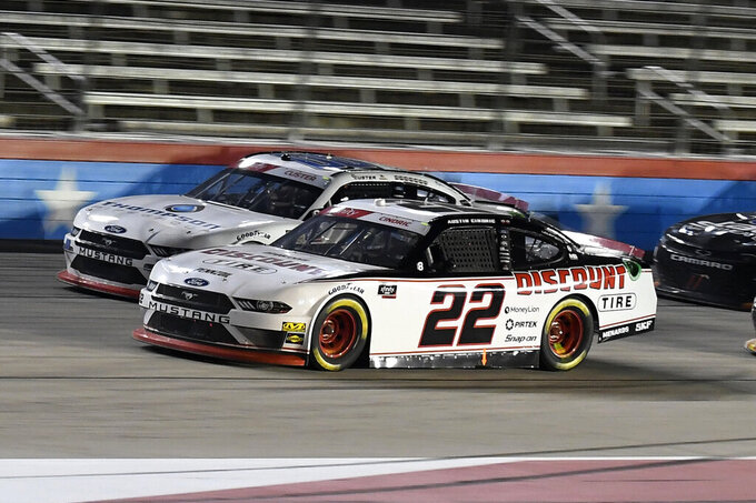 Austin Cindric (22) heads into the front stretch during the NASCAR Xfinity Series auto race at Texas Motor Speedway in Fort Worth, Texas, Saturday, Nov. 2, 2019. (AP Photo/Randy Holt)