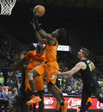 Oklahoma State guard Isaac Likekele, left, drives past Baylor guard Makai Mason, right, in the first half of an NCAA college basketball game, Wednesday, March 6, 2019, in Waco, Texas. (Rod Aydelotte/Waco Tribune-Herald via AP)
