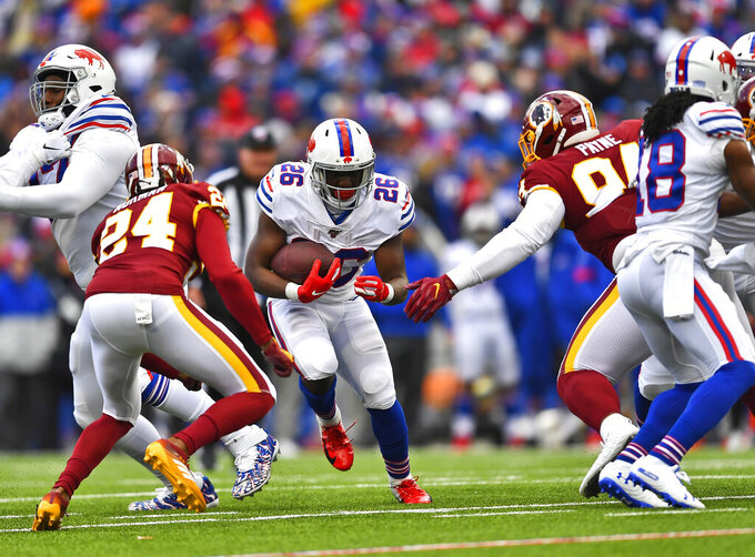 Buffalo Bills running back Devin Singletary (26) rushes for four yards during the first half of an NFL football game against the Washington Redskins, Sunday, Nov. 3, 2019, in Orchard Park, N.Y. (AP Photo/Adrian Kraus)