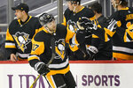 Pittsburgh Penguins' Bryan Rust (17) returns to the bench after scoring during the second period of an NHL hockey game against the New York Rangers in Pittsburgh, Sunday, Jan. 24, 2021. (AP Photo/Gene J. Puskar)