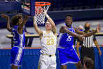 Notre Dame's Dane Goodwin (23) goes up for a shot between Duke's DJ Steward (2) and Mark Williams (15) during the first half of an NCAA college basketball game Wednesday, Dec. 16, 2020, in South Bend, Ind. (AP Photo/Robert Franklin)