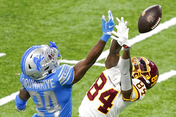 Detroit Lions cornerback Amani Oruwariye (24) deflects a pass intended for Washington Football Team wide receiver Jeff Badet (84) during the second half of an NFL football game, Sunday, Nov. 15, 2020, in Detroit. (AP Photo/Carlos Osorio)