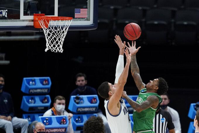 North Texas's Javion Hamlet (3) shoots over Villanova's Cole Swider (10) during the first half of a second-round game in the NCAA men's college basketball tournament at Bankers Life Fieldhouse, Sunday, March 21, 2021, in Indianapolis. (AP Photo/Darron Cummings)