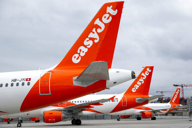 FILE - In this Monday, March 30, 2020 file photo, a large number of easyJet aircrafts parked on the tarmac of the Geneve Aeroport, in Geneva, Switzerland. British airline easyJet has posted its first full-year loss in its 25-year history as a result of the coronavirus pandemic. It laid out hope, however, that the rollout of vaccines will help it bounce back strongly next year. The airline reported a pretax loss of 1.27 billion pounds ($1.7 billion) for the year through September compared with a profit of 430 million pounds for the previous year. P (Salvatore Di Nolfi/Keystone via AP, File)