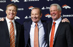 FILE - In this Jan. 14, 2011, file photo, Denver Broncos NFL football team owner Pat Bowlen is flanked by John Elway, left, Executive V.P. of football operations and John Fox, head coach, at the teams headquarters in Englewood, Colo. Pat Bowlen, the Denver Broncos owner who transformed the team from also-rans into NFL champions and helped the league usher in billion-dollar television deals, died late Thursday night, June 13, 2019, just under two months before his enshrinement in the Pro Football Hall of Fame. He was 75. In a statement posted on the Broncos' website, Bowlen's family said he died peacefully at home surrounded by loved ones. (AP Photo/ Ed Andrieski, File)