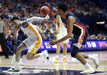 Tennessee's Lamonte Turner, left, loses control of the ball as Auburn's Chuma Okeke, right, watches in the second half of the NCAA college basketball Southeastern Conference championship game Sunday, March 17, 2019, in Nashville, Tenn. (AP Photo/Mark Humphrey)